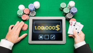 12275245-casino-poker-player-with-cards-tablet-and-chips